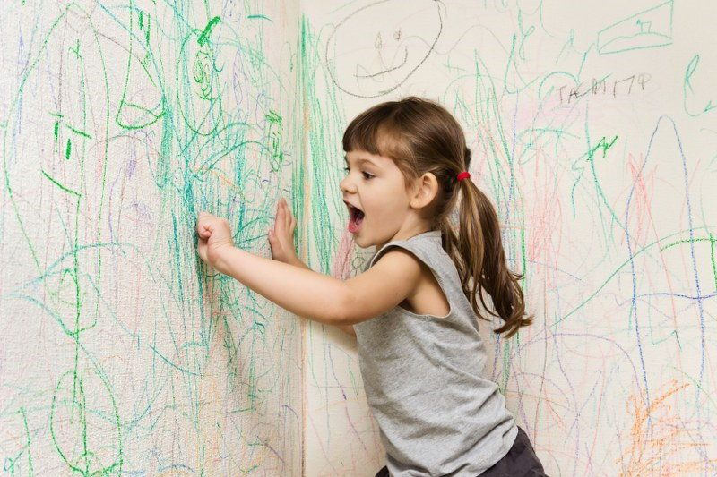 scribbling all over the walls