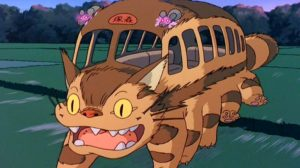 The catbus from My Neighbor Totoro, a bus with a cat's face and fur and ten cat legs