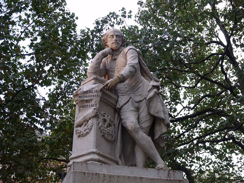 "Statue of William Shakespeare captioned ""The Only Darkness is Ignorance"""