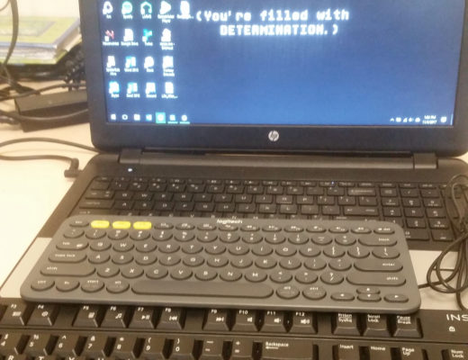A laptop with three keyboards